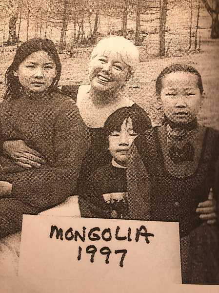 COURTESY PHOTO  - Esther Halvorson-Hill and children from Mongolia on a visit Halvorson-Hill took as a nurse years ago.