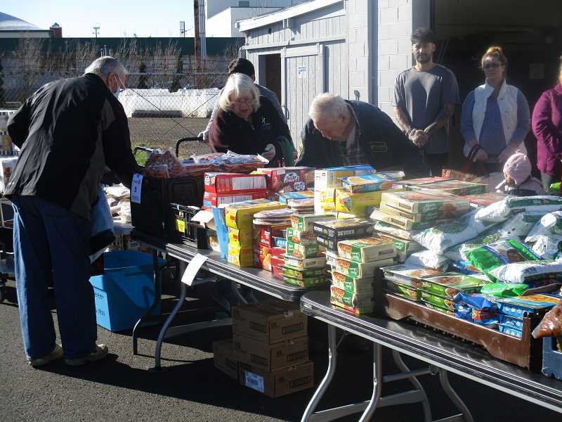 DEBORAH GUINTHER - A sunny Tuesday morning brought out a good crowd to The Canby Center's food pantry.