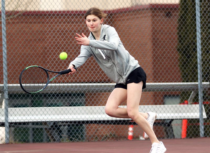 PMG FILE PHOTO: DAN BROOD - Tigard High School senior Emma Parker, shown here in a match from last year, returns in the No. 1 singles spot for the Tigers this season.