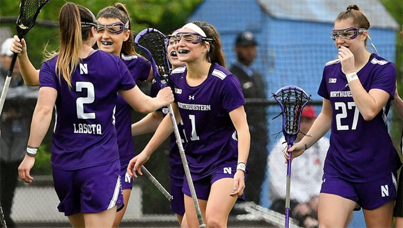 COURTESY PHOTO: NORTHWESTERN UNIVERSITY - Lake Oswego's Lauren Gilbert (center, no. 1) was all smiles early in the year for the Northwestern University women's lacrosse team before the WIldcats' season was canceled.