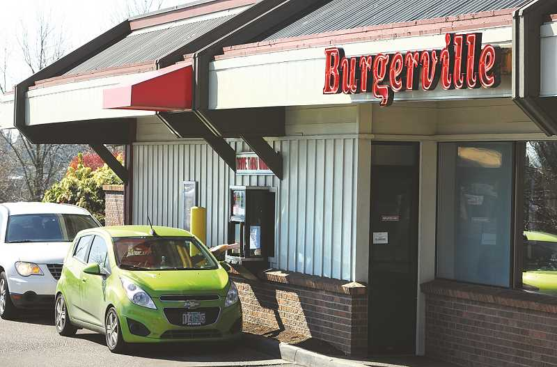 GRAPHIC PHOTO: GARY ALLEN - The Newberg Burgerville store was one of the first restaurants in the area to transition to pick-up and drive-through service.
