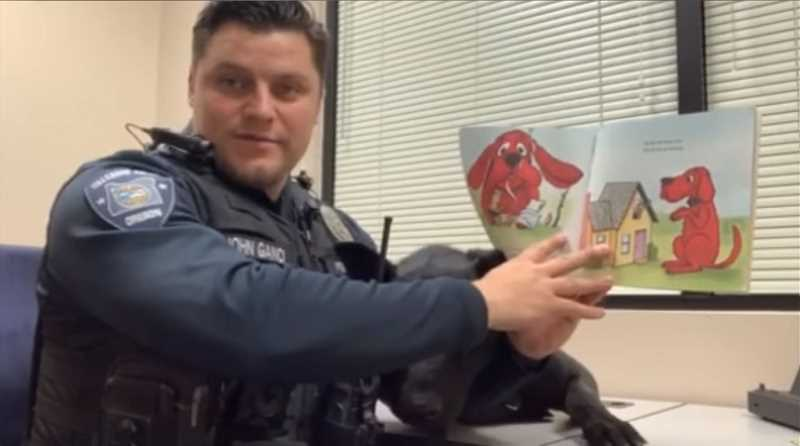 COURTESY IMAGE - In a video posted to the Hillsboro Police Department's Facebook page, Officer John Canci reads 'Clifford the Big Red Dog.'