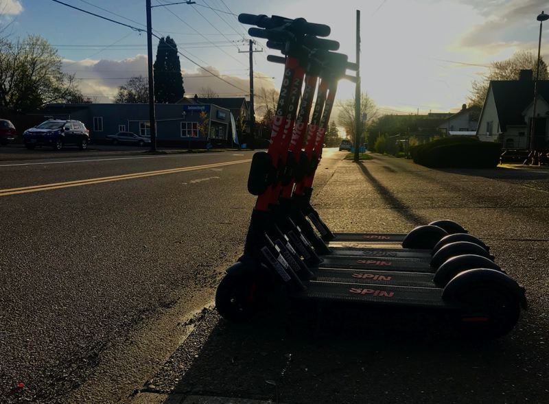 PMG PHOTO: ZANE SPARLING - Spin electric scooters were lined up on Northeast Killingsworth Street in Portland on March 31.