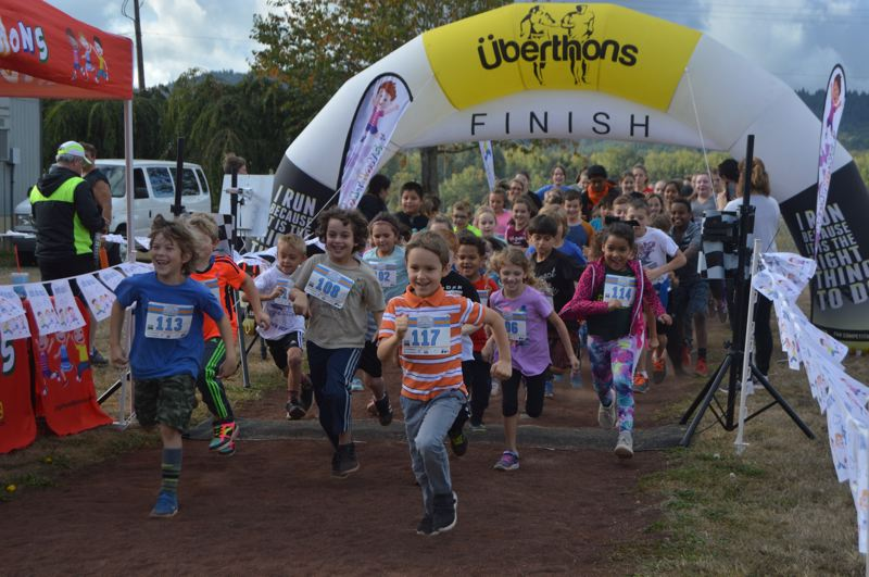 PMG FILE PHOTO - Students at Sauvie Island School take part in a jog-a-thon fundraiser in 2018 to help pay for classroom technology like iPads.
