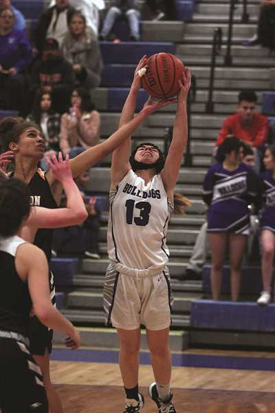 PMG PHOTO: PHIL HAWKINS - Woodburn senior Taiya Kent was selected to the Honorable Mention team. Kent led the Bulldogs in rebounds, recording three double-doubles in the season, including a season-high 15 boards against Newport on Feb. 18.
