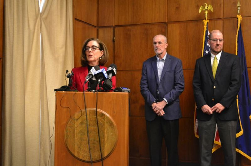 PMG FILE PHOTO - Gov. Kate Brown, Greg Miller (left) representing the forest industry, and Bob Van Dyk (right) of the Wild Salmon Center announce the landmark deal between the two sides at the Oregon Capitol on February 10.