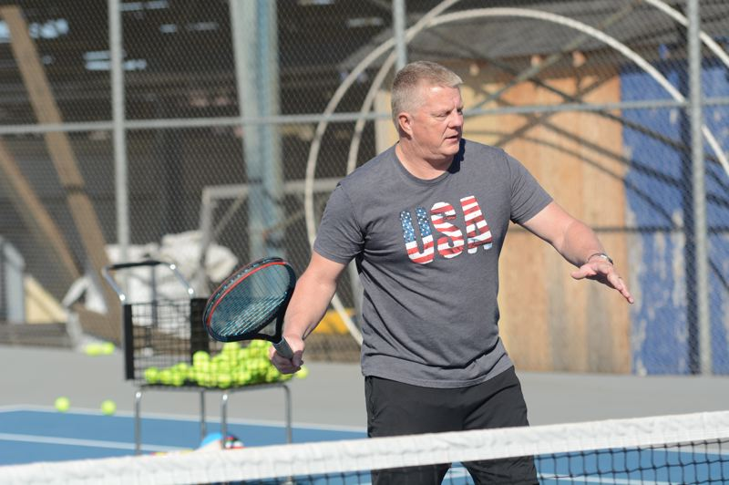 PMG PHOTO: DEREK WILEY - Dave Brown is taking over the Canby girls tennis program after coaching 20 years at Newberg.