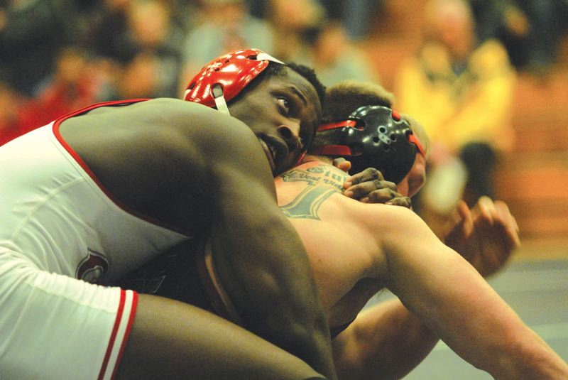 PMG PHOTO: DAVID BALL - David Douglas wrestling standout Ihog Odighizuwa was one of three Scots to have their arms raised after title bouts during the teams run to the 6A championship in 2013.