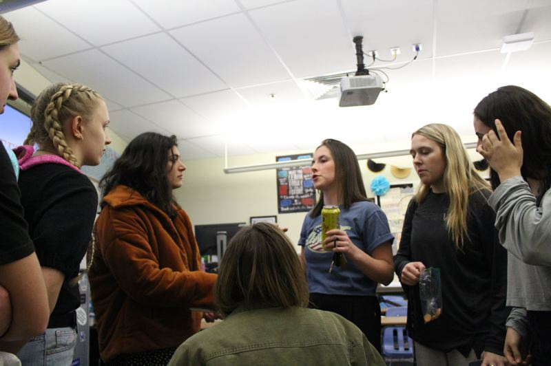 PGM PHOTO: ASIA ALVAREZ ZELLER - Laurel Finlay (center) talks with peers during a club meeting on the last day of school before closures.