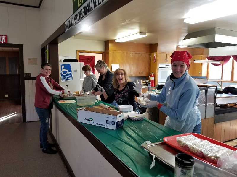 Volunteers at the Beavercreek Grange put together free meals for local families during the COVID-19 crisis.