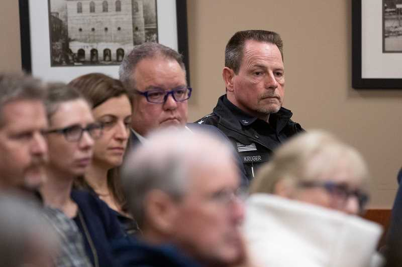 PMG PHOTO: JON HOUSE - West Linn Police Chief Terry Kruger listens to public testimony calling for his firing during a special session of the City Council addressing a racially-charged false arrest in 2017., West Linn Tidings - News