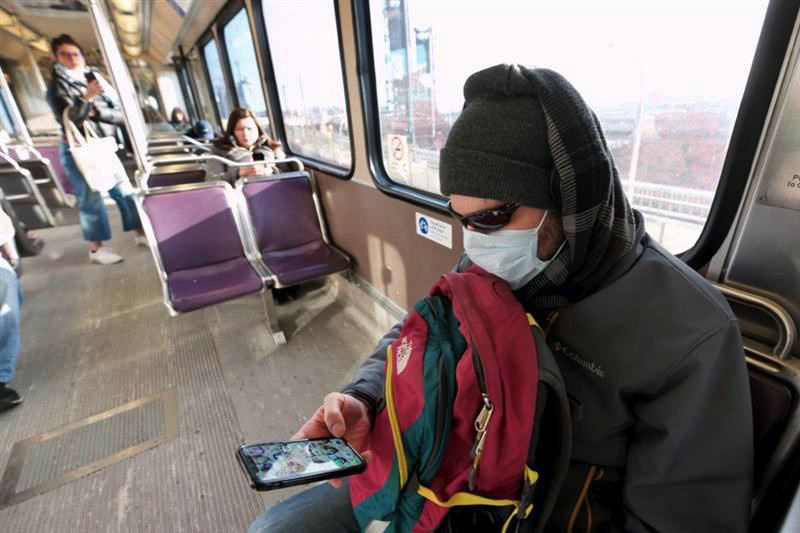 PMG PHOTO: JAIME VALDEZ - A TriMet MAX passenger rode through central Portland wearing a face mask recently.