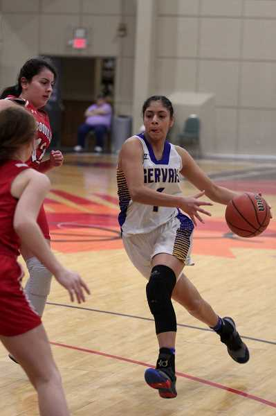 PMG PHOTO: PHIL HAWKINS - Gervais junior Araceli Vasquez led the Cougars in scoring, 3-pointers and blocks, helping the girls basketball team return to the state quarterfinal tournament for the firs ttime since the 1994-95 season.