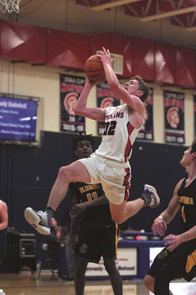 PMG PHOTO: PHIL HAWKINS - Kennedy senior Luke Hall averaging 19.9 points per game for the Trojans, including 59 percent on 2-pointers, 41 percent on 3s and 76 percent from the free throw line.
