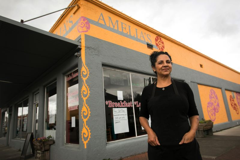 PMG PHOTO: JAIME VALDEZ - Amelia Ramirez stands in front of Amelia's Exquisite Mexican Dining that is owned by her son, Josue Mondragon, in downtown Hillsboro. Mondragon named the restaurant in honor of his mom.