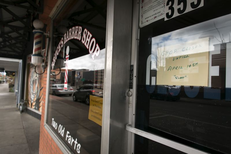 PMG PHOTO: JAIME VALDEZ - A sign on Bruce's Barber Shop window in downtown Hillsboro states it will be closed until April 14.