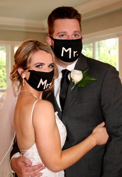 COURTESY PHOTO: SHERRY MICHENER - MaKayla Michener and Nathan Smith had matching protective masks to stay safe during their wedding.