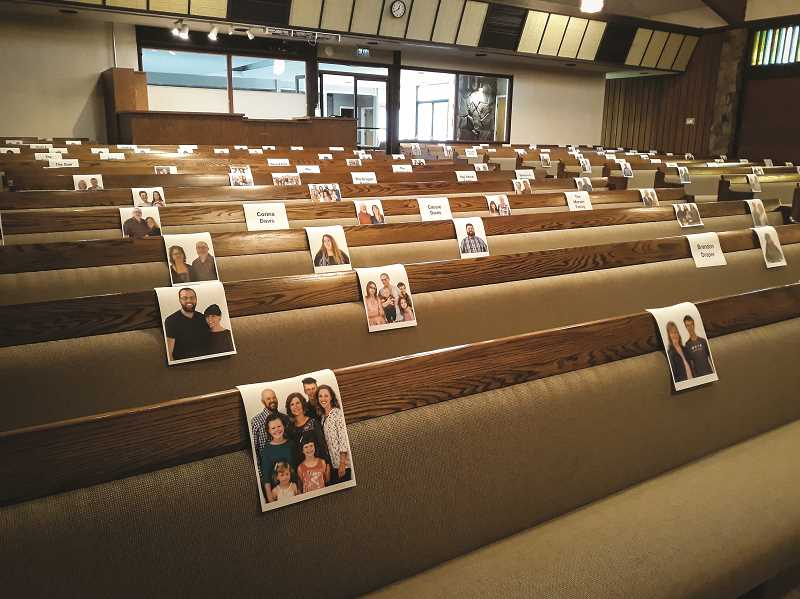 PHOTO SUBMITTED BY DALLAS HALL  - First Baptist Church Pastor Mike Phay looks out at photographs from his congregation while live-streaming sermons to members' homes. Phay is just one of several pastors who have had to address church-goers online.