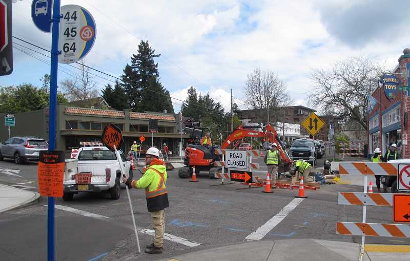 PMG PHOTOS: BILL GALLAGHER - Crews returned to Multnomah Village on Monday, April 6 to foinsih the paving wrok begun in 2019.