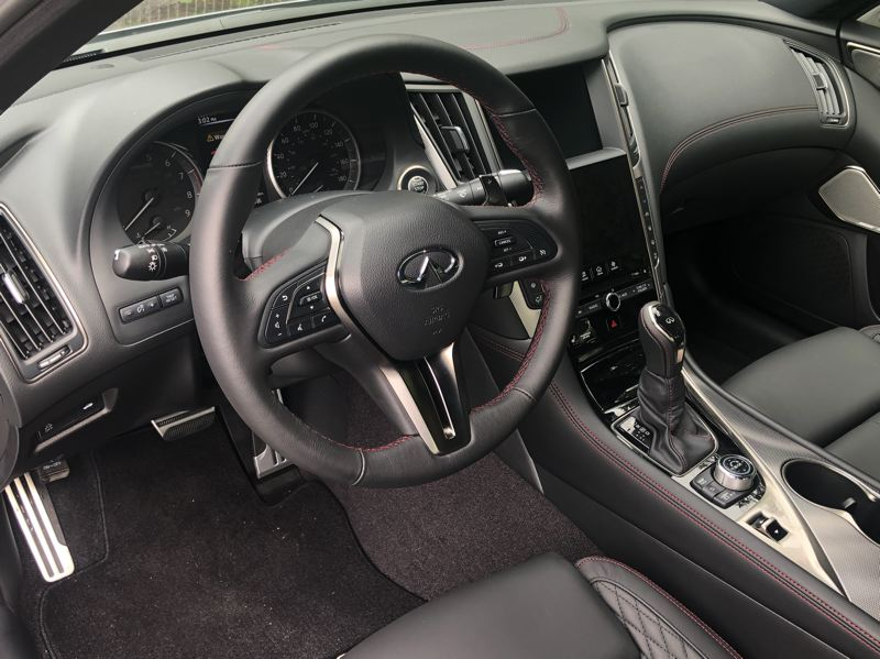 PMG PHOTO: JEFF ZURSCHMEIDE - The icockpit in the 2020 infiniti Q50 caters to the driver with big guages and easy-to-use controls.