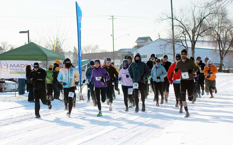 BILLY GATES/THE PIONEER - A dedicated group of 44 runners take off from the starting line of the Canyon Rumble Frozen Half Marathon. Now the MADras Runners are challenging local runners to a five-week event.