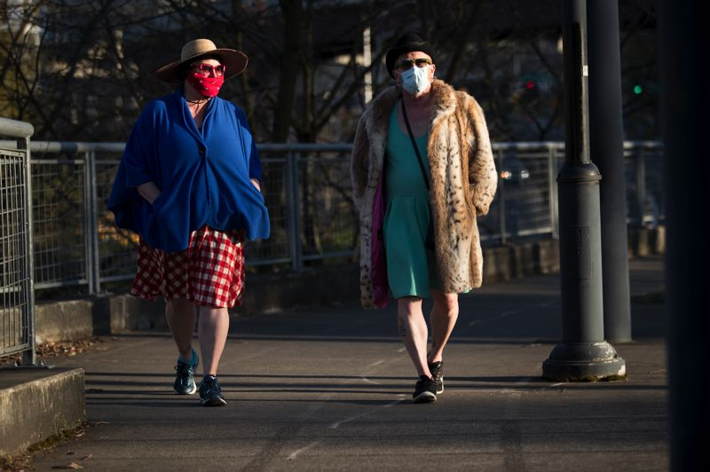 PMG PHOTO: JAIME VALDEZ - Portlanders are getting outside: Dollie Baughn (left) and Tory Mitchell, who live in downtown Portland, took an evening stroll in the sun Tuesday.