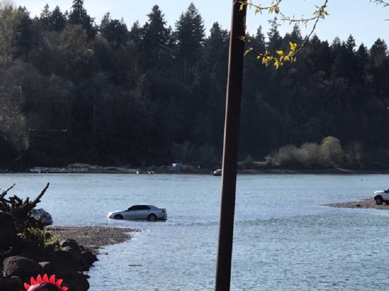 COURTESY PHOTO - On April 7, during the last evening Meldrum Bar Park was open to vehicles, a car gets flooded on the bar as the tide comes in. Gladstone officials closed vehicular access to the park starting April 8 until further notice, due to COVID-19 concerns.