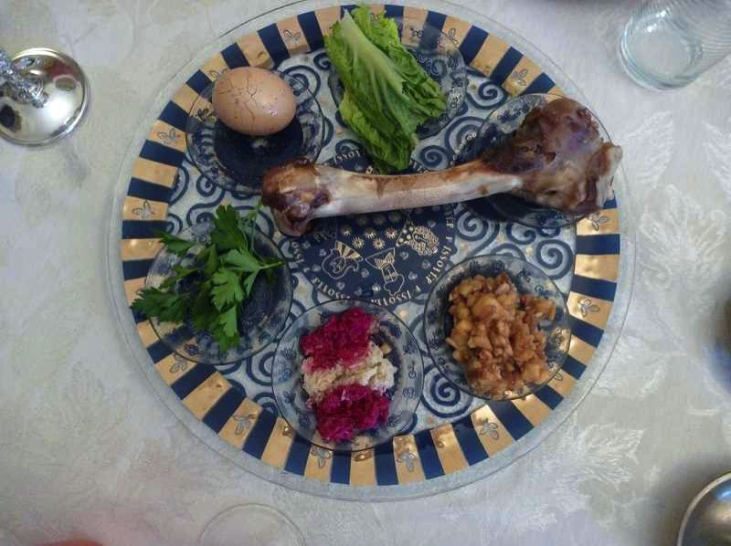 PMG FILE PHOTO - The Seder plate can be fancy or ordinary, as long as it has the main symbols of passover: the roasted bone, the hardboiled egg, the bitter herbs and more. What Seders can't have this year are large gatherings, thanks to the quarantine.