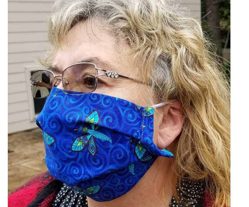 COURTESY PHOTO - Susan Woodworth, a retired RN from Oregon City, models one of her sewn N95 mask covers.