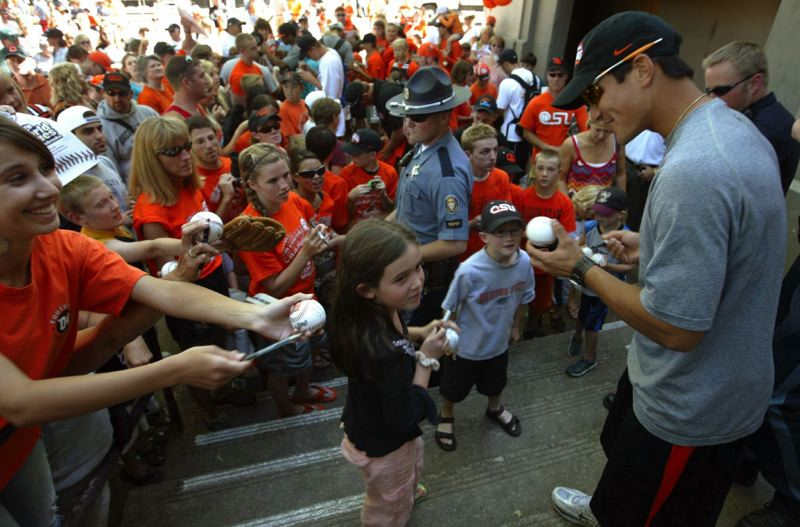 PMG FILE PHOTO: L.E. BASKOW - OSU's Darwin Barney (right) gladly signs autographs for fans as the OSU baseball team was welcomed home after winning its second College World Series title in 2007. He's now a Triple-A manager.