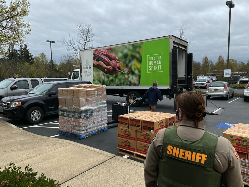 COURTESY OF CLACKAMAS COUNTY SHERIFF'S OFFICE - The Oregon Food Bank delivers boxes of food for care packages to the Clackmas County Public Safety Training Center last week for delivery as part of the Community Cares Initiative.