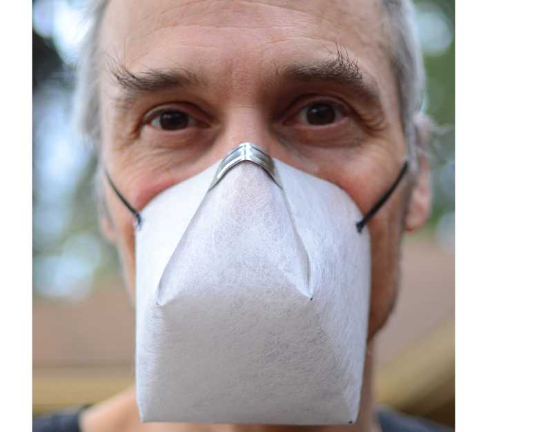 COURTESY PHOTO - Michael Leoniak models asimple solution to make a mask from a single sheet of material.