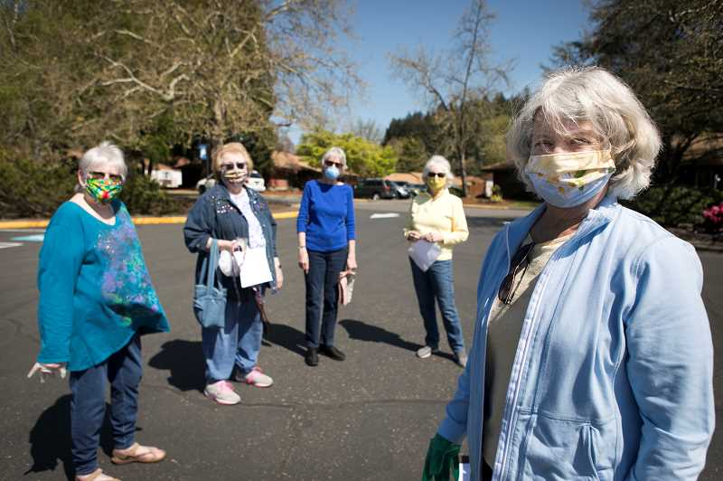 PMG PHOTO: JAIME VALDEZ - Kathy Chase, front, and the ladies behind her, Carol Springer, left, Judy Kilgore, Shirley Schultz and Diane Campbell, members of Tualatin Valley Quilting Guild, non-medical cotton masks for the Veterans Affairs Medical Center in Portland.