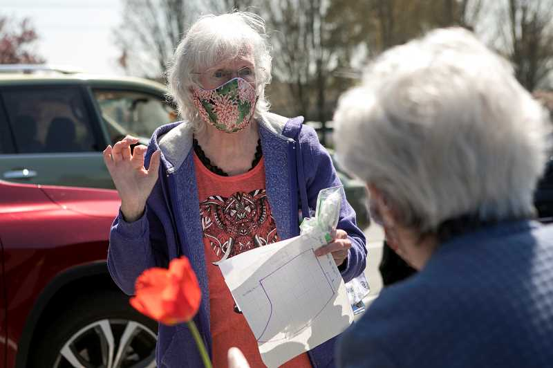 PMG PHOTO: JAIME VALDEZ - Michelle Faber talks with Eleanore Mickus about the masks made for the Veterans Affairs Medical Center in Portland.