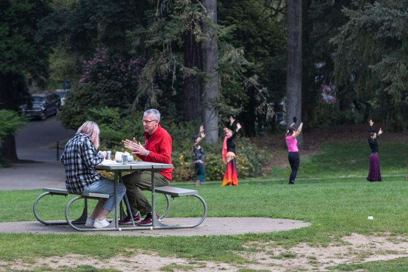 PMG PHOTO: JONATHAN HOUSE - Parkgoers in Laurelhurst Park enjoyed lunch, or belly dancing, on a sunny Saturday, April 11 in Portland.