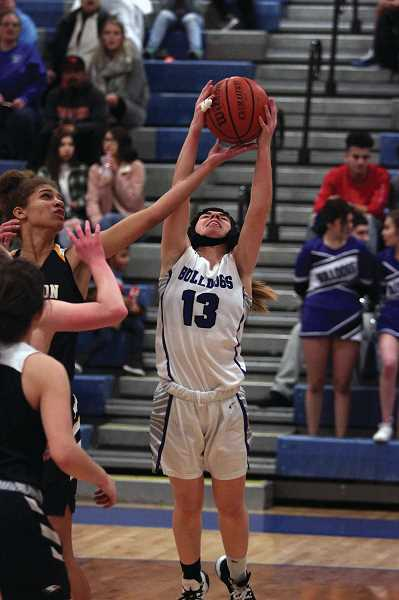 PMG FILE PHOTO: PHIL HAWKINS - Kent reinvented her game for her senior season in an effor to mitigate risk of reinjury, focusing on rebounding and defense for the Bulldogs.