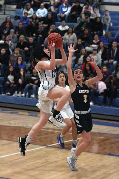 PMG FILE PHOTO: PHIL HAWKINS - Taiya Kent and her younger sister Aria (background) formed a potent backcourt duo for the Bulldogs, combing to average 25 points, 10 rebounds, 7 assists, 4.5 steals and a block a game against the Oregon West Conference.