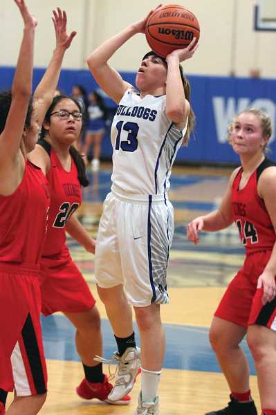 PMG FILE PHOTO: PHIL HAWKINS - Taiya Kent's sophomore season ended after two quarters, hitting her head on the floor at the end of the first half against the Bulldogs' season opener vs. North Salem on Dec. 1, 2017.