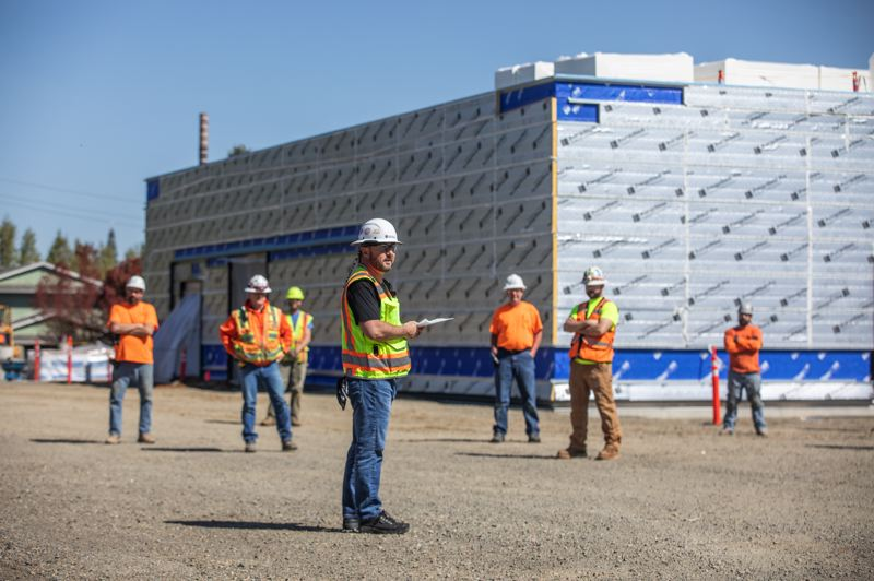 PAMPLIN MEDIA GROUP: JONATHAN HOUSE  - There was a stand down to learn about CDC rules for social distancing on the job site during the time of coronavirus in Oregon City, at the site of the Robert Libke Public Safety Facility at 1232 Linn Avenue. It will be the Oregon City Police Department and municipal court. It is being built of cross-laminated timber panels and glulam beams. Safety Officer Rick McMurry addresses the workers.