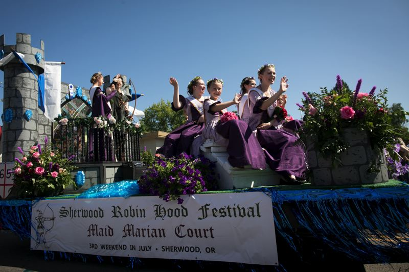 PMG PHOTO: JAIME VALDEZ - The Sherwood Robin Hood Festival Maid Marian Court make their way down Southwest Pine Street during the Robin Hood Festival Parade in 2017.