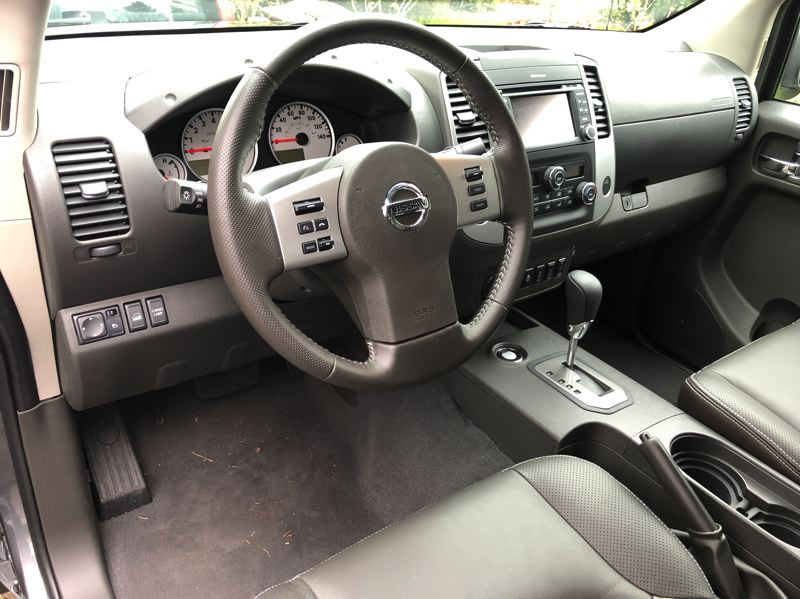 PMG PHOTO: JEFF ZURSCHMEIDE - The interior of the 2020 Nissan Frontier is clean and simple, with controls that can be easily operated while wearing work gloves.