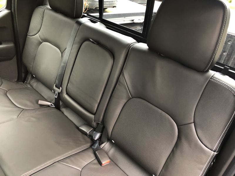 PMG PHOTO: JEFF ZURSCHMEIDE - Three adults car actual fit into the rear seats of the 2020 Nissan Frontier, at least for reasonable trips.