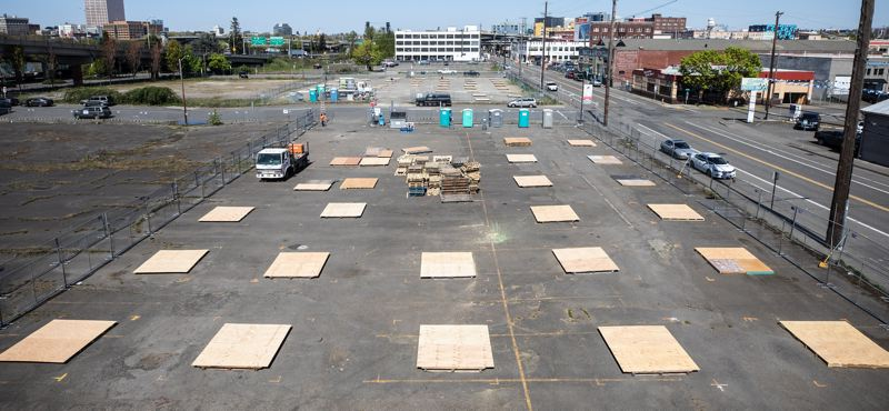 PMG PHOTO: JONATHAN HOUSE - Pallets were laid out by workers prepping a new temporary outdoor homeless shelter along Southeast Water Avenue at Salmon Street in Portland.