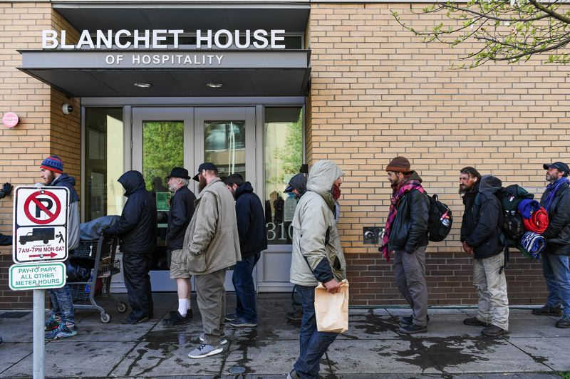 COURTESY: JUSTIN KATIGBAK - People line up for free meals outside Blanchet House in Portland. The nonprofit is distributing 10,000 meals a week currently, double what was provided before the COVID-19 outbreak.