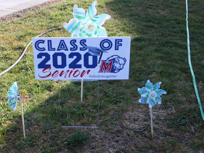 JENNIFFER GRANT/MADRAS PIONEER - Signs celebrating the Class of 2020 are popping up all over Madras with the hashtag #allinthistogether. School officials are still deciding how to proceed with graduation.