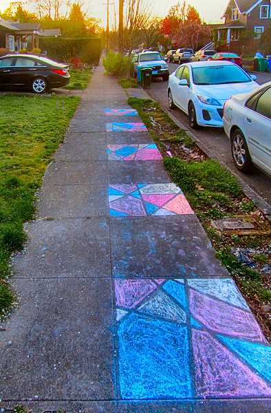 ERIC NORBERG - Sidewalk chalk art gained a new dimension in April, as kids all over Southeast Portland spent time doing art projects on the concrete with masking tape and colored chalk. Here, on the morning of April 8, we found five carefully-created panels in a row, each a bit different.