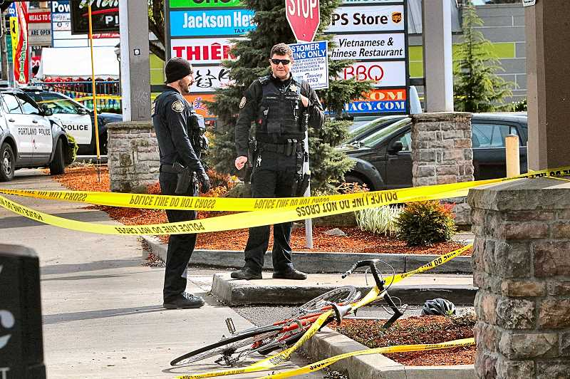 DAVID F. ASHTON - Officers guarded the bicycle that may have been the one stolen from the nearby pawn shop.