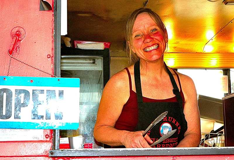 DAVID F. ASHTON - Getting ready to reopen at her Road Runner Mesquite Barbecue in Carts on Foster at S.E. Foster and 52nd, heres the Queen of Mesquite Smoke - Tammy Hart.