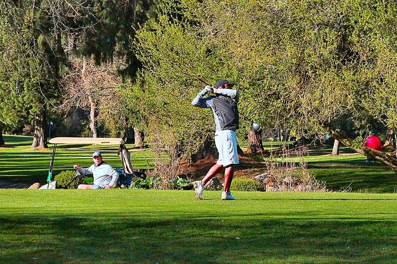 DAVID F. ASHTON - On recent lovely spring afternoons, golfers were still welcome to play their game at the Eastmoreland Golf Course.