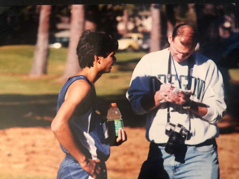 CENTRAL OREGONIAN - Dave Richard, right, interviews a Crook County High School runner post race. Richards was the Central Oregonian sports editor from 1999-2003. He went on to take management roles in other newspapers but is now in the healthcare industry.